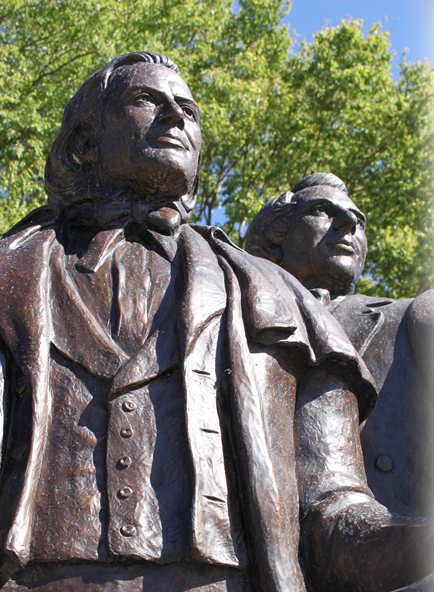 Brigham Young and Joseph Smith look West